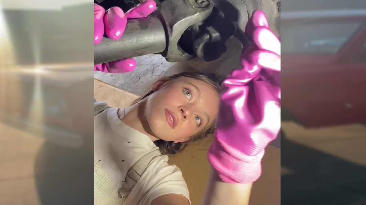 Actress Sydney Sweeney working on her 1969 Ford Bronco.