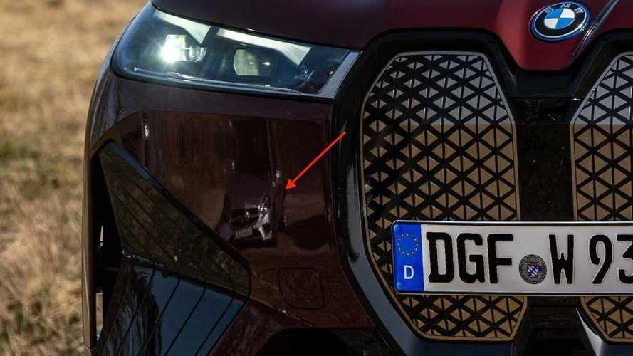 A Mercedes Photo Bombs a BMW iX photo shoot