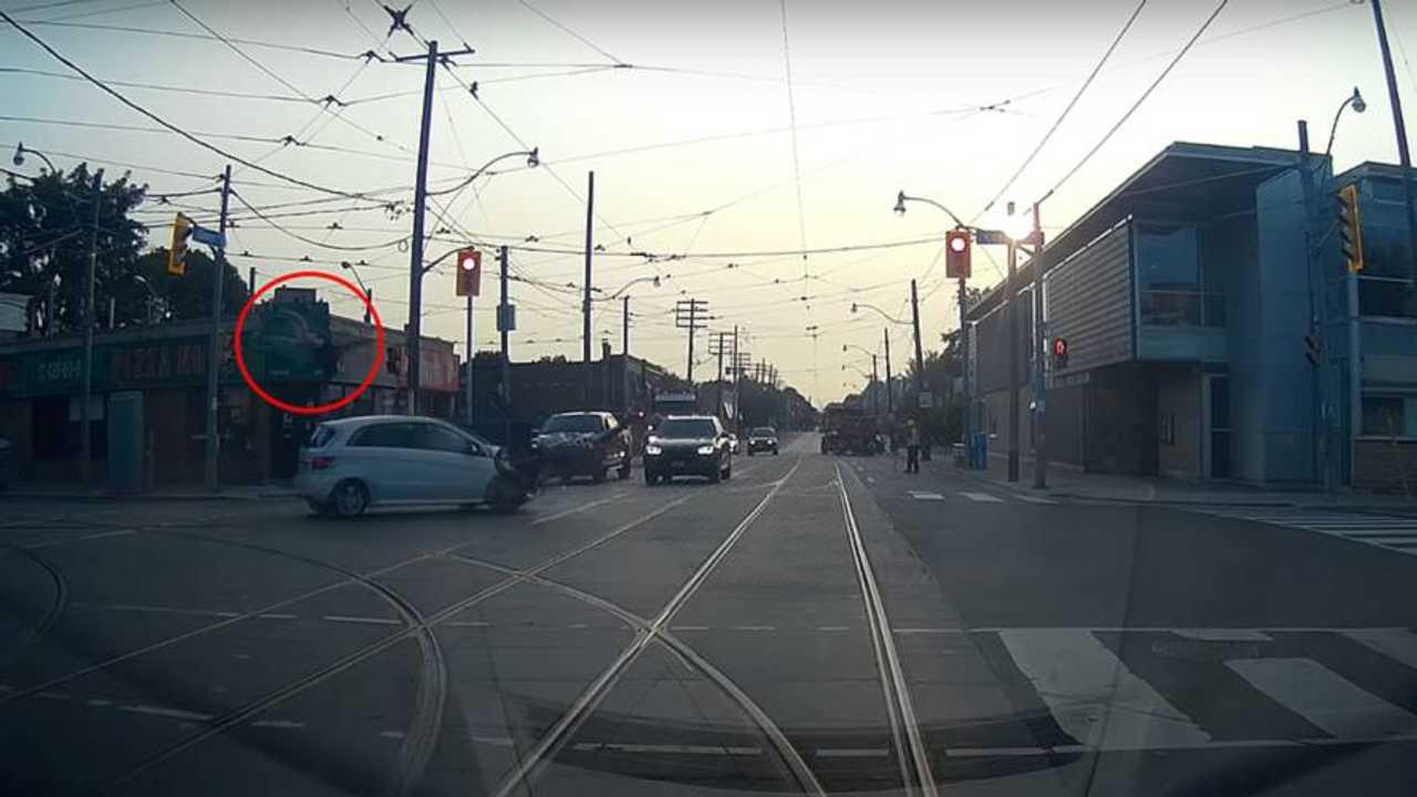 Watch a Car Send Rider Flying Off His Bike
