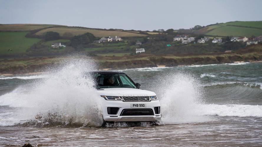 Range Rover Sport PHEV Wades Into The Sea, Races Pro Swimmers