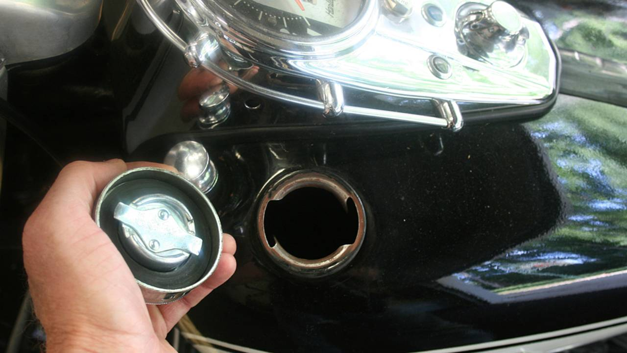 Avoid the temptation to stick something in your gas tank to check for gas.