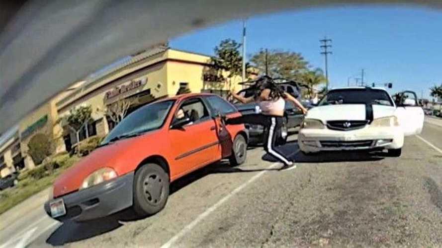 Watch crazy lady karate kicking car caught on TeslaCam
