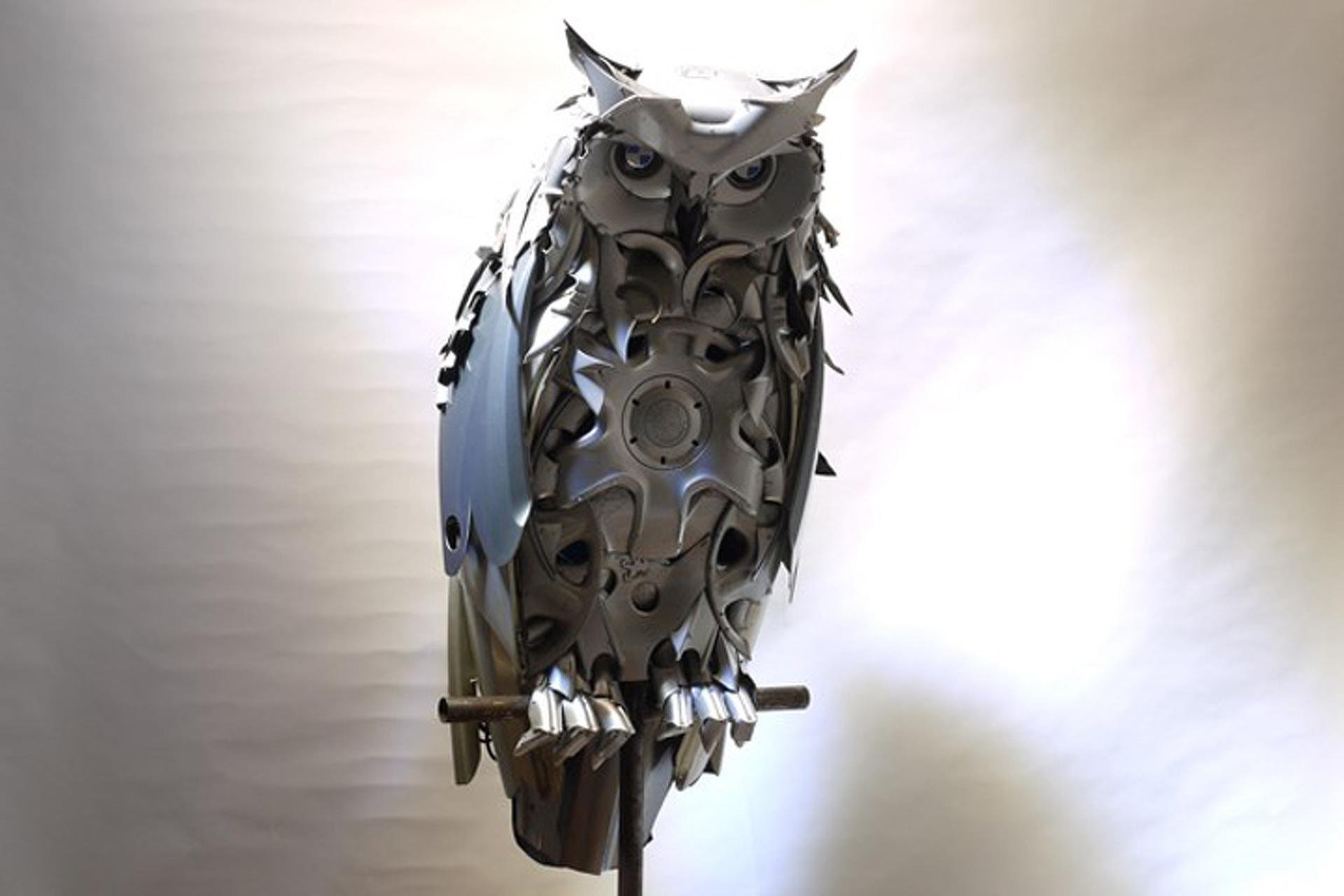 Artist Turns Hubcaps into Amazing Animal Sculptures