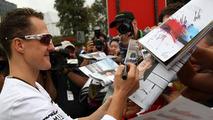 Michael Schumacher (GER), Mercedes GP Petronas signing autographs, Australian Grand Prix, 28.03.2010 Melbourne, Australia