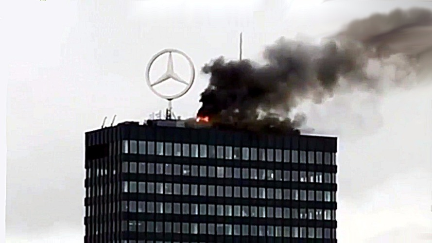 Iconic Berlin Mercedes-Benz emblem in fire drama