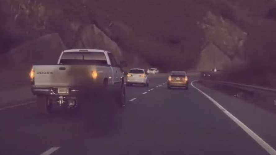 Watch Ram Pickup Truck Coal Roll A Tesla Model 3