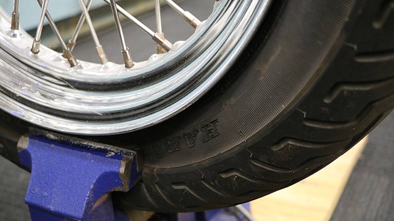 <em>The bead can often be tough to break and require putting pressure on the tire at multiple points to work it loose from the rim.</em>