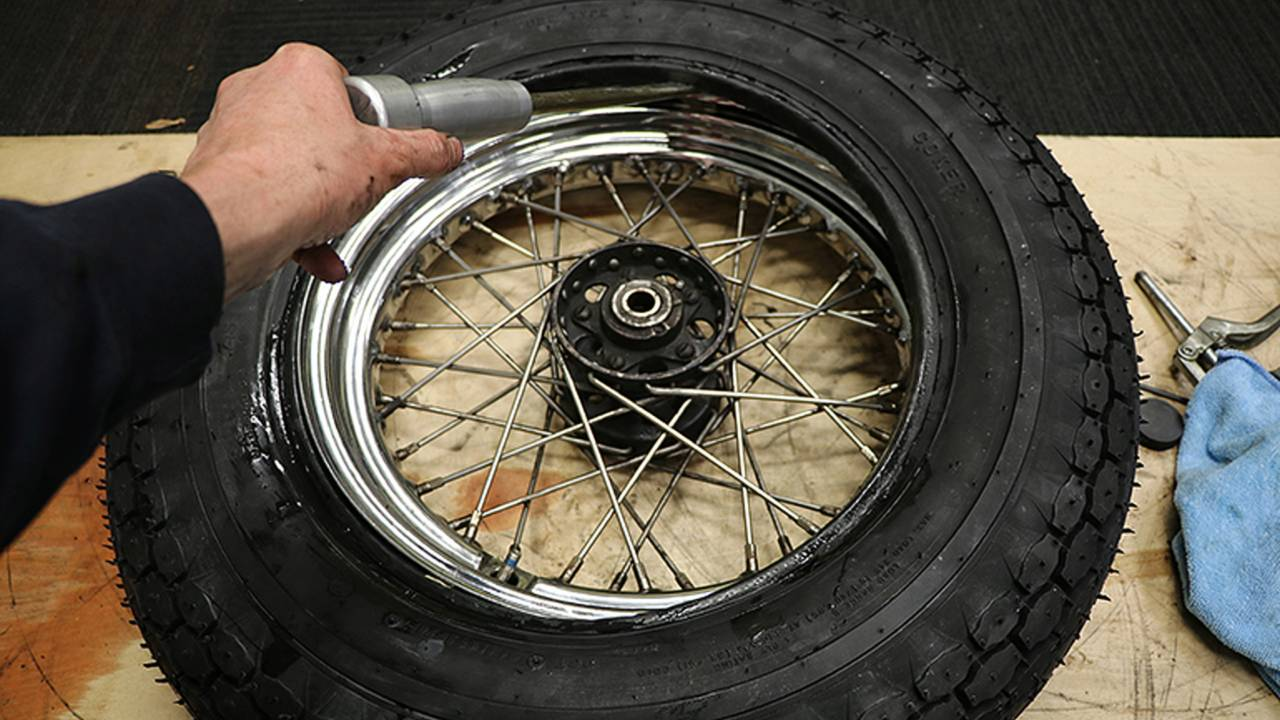 <em>If running a tube, make sure you do not rest the edge of the tire iron on the tube (which can puncture it) or get the tube pinched between the rim and the tire.</em>