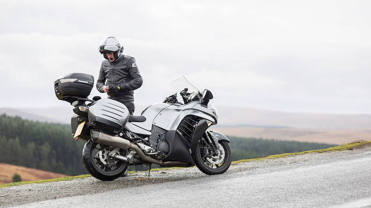 <em>Flip-front helmet? Check. Bluetooth headset? Check. Leather touring suit? Check. I'm hitting all the sport-tourer rider cliches.</em>