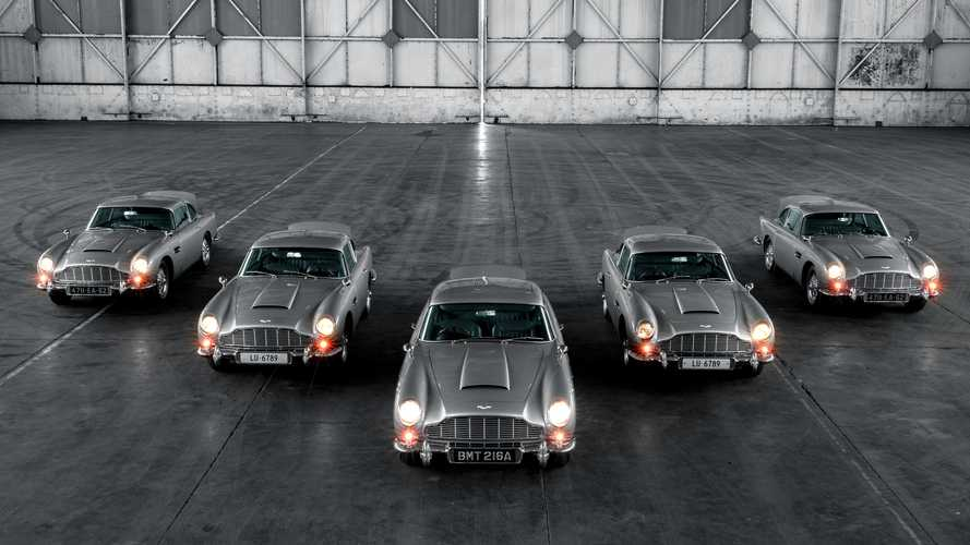 Five Aston Martin DB5 continuation cars fire their fake machine guns