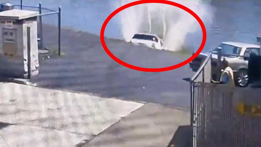 Watch woman drive out of car wash directly into river
