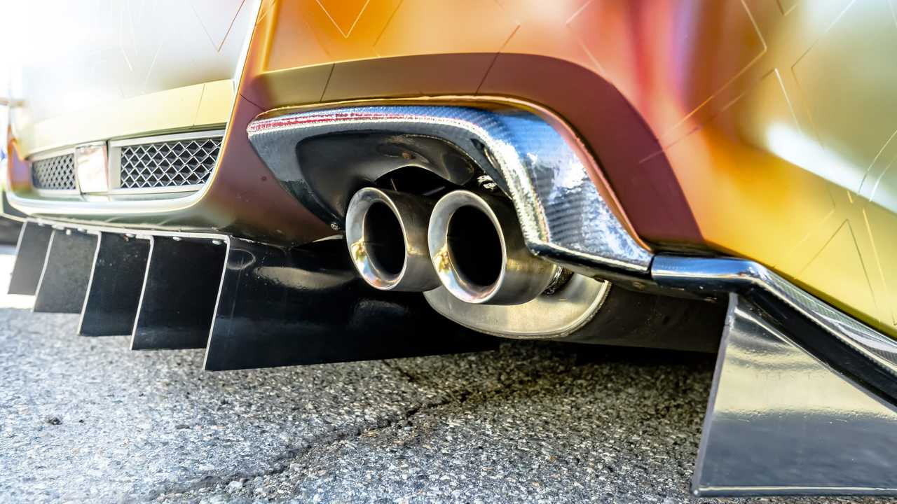 Customised car with dual exhaust pipes