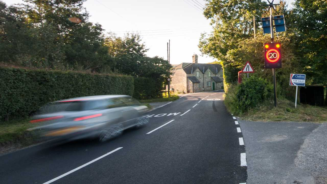 Speeding car activates electronic speed limit sign in Melbury Abbas village Shaftesbury UK
