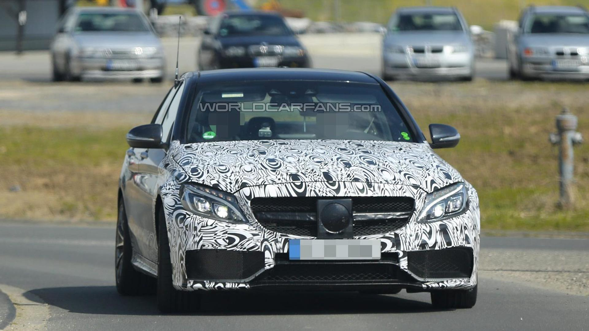 Mercedes Benz C63 Amg Sedan Spied Wearing Less Camo On Front