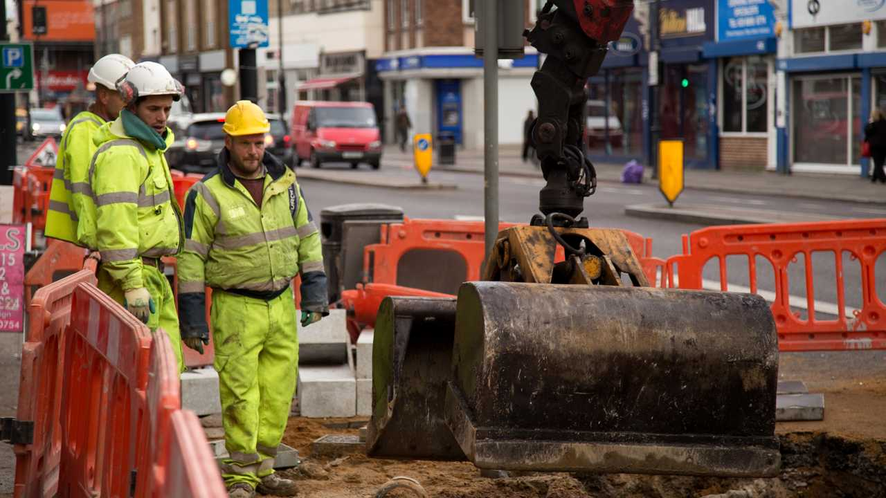 Loughlin labourers repaving the street in London