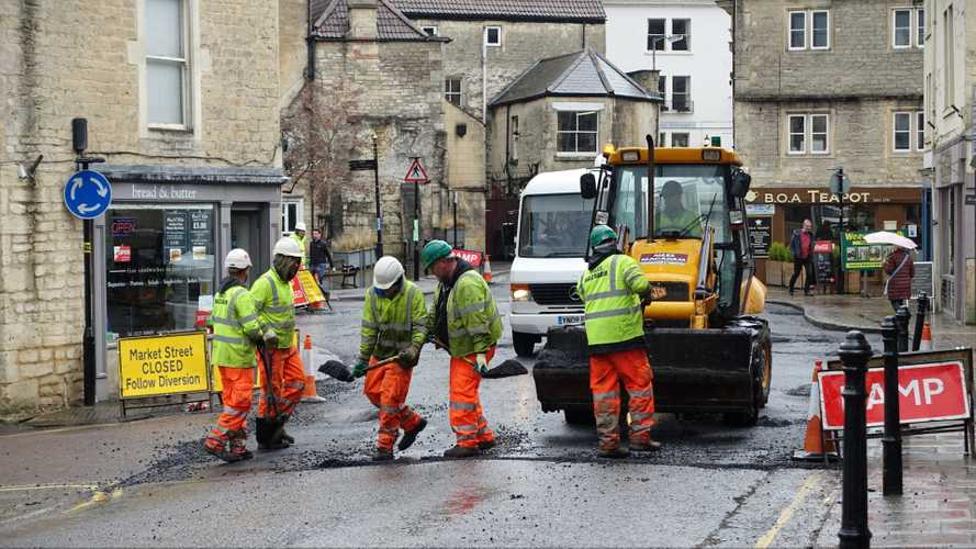 Road workers resurfacing road in Bradford on Avon UK town centre