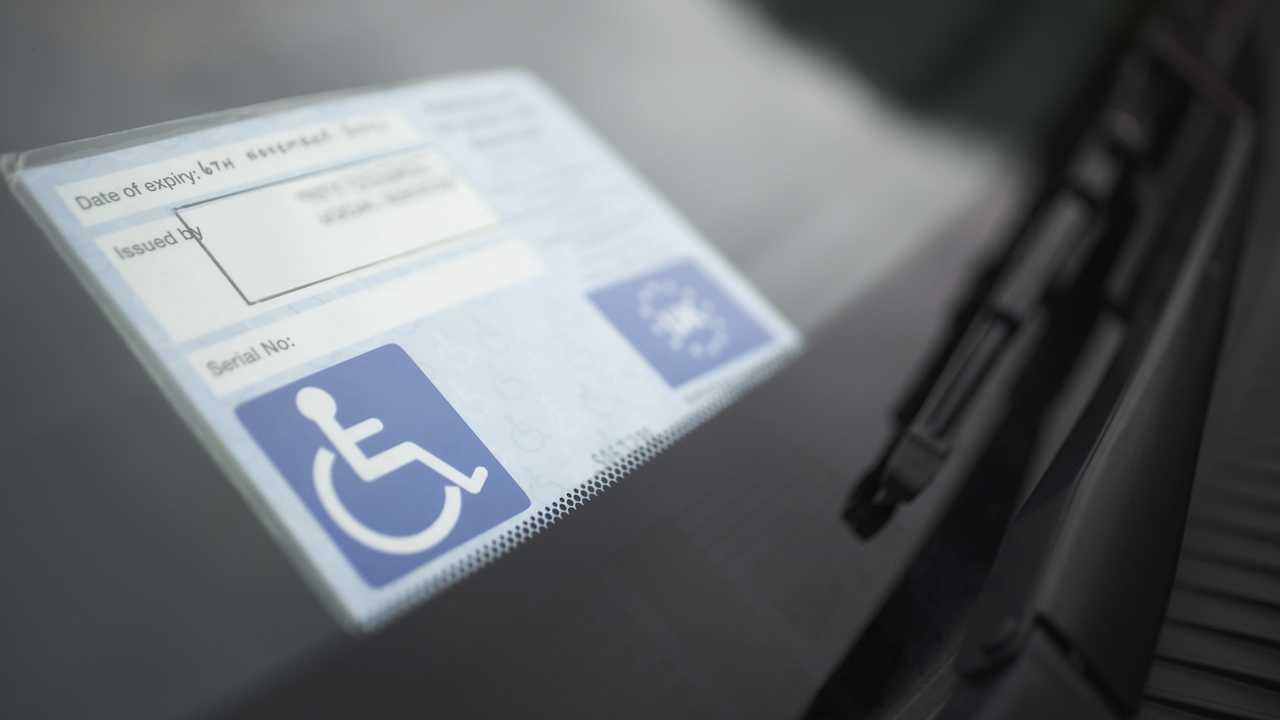 Handicapped parking badge on car windscreen
