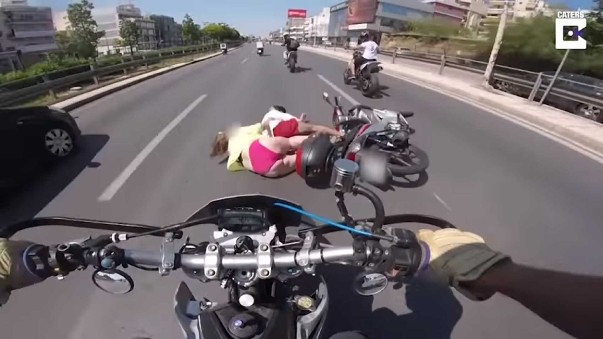 "[""Bikini-Clad Scooter Pillion Crash""]"
