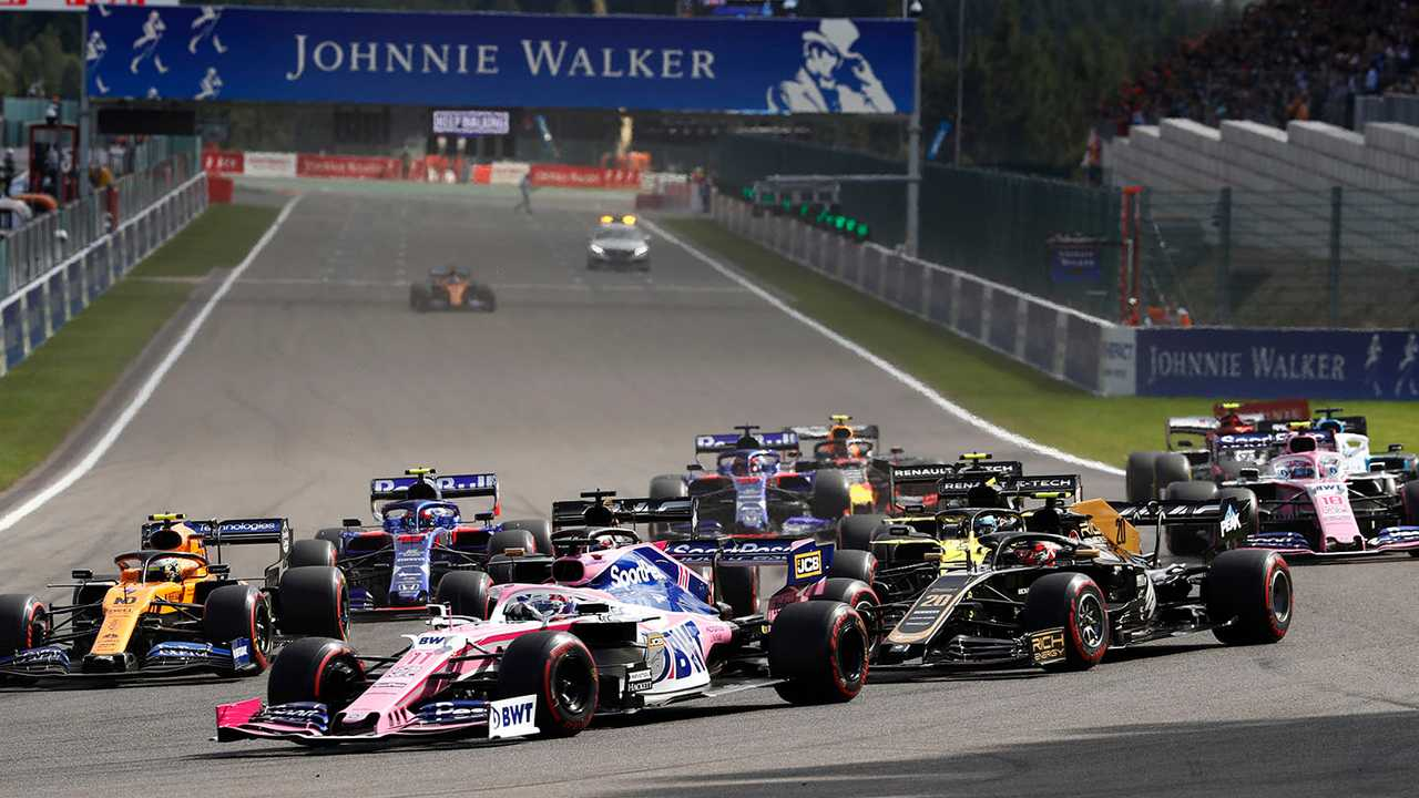 Sergio Perez, Racing Point RP19, leads Kevin Magnussen, Haas F1 Team VF-19, Lando Norris, McLaren MCL34, Romain Grosjean, Haas F1 Team VF-19, Daniel Ricciardo, Renault F1 Team R.S.19, and the remainder of the field at the start