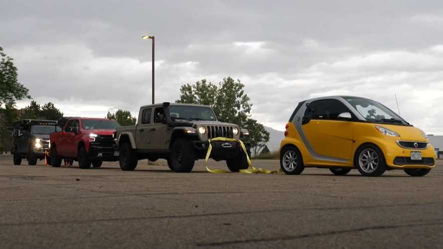 Can A Tiny Electric Car Tow Three Pickup Trucks At The Same Time?