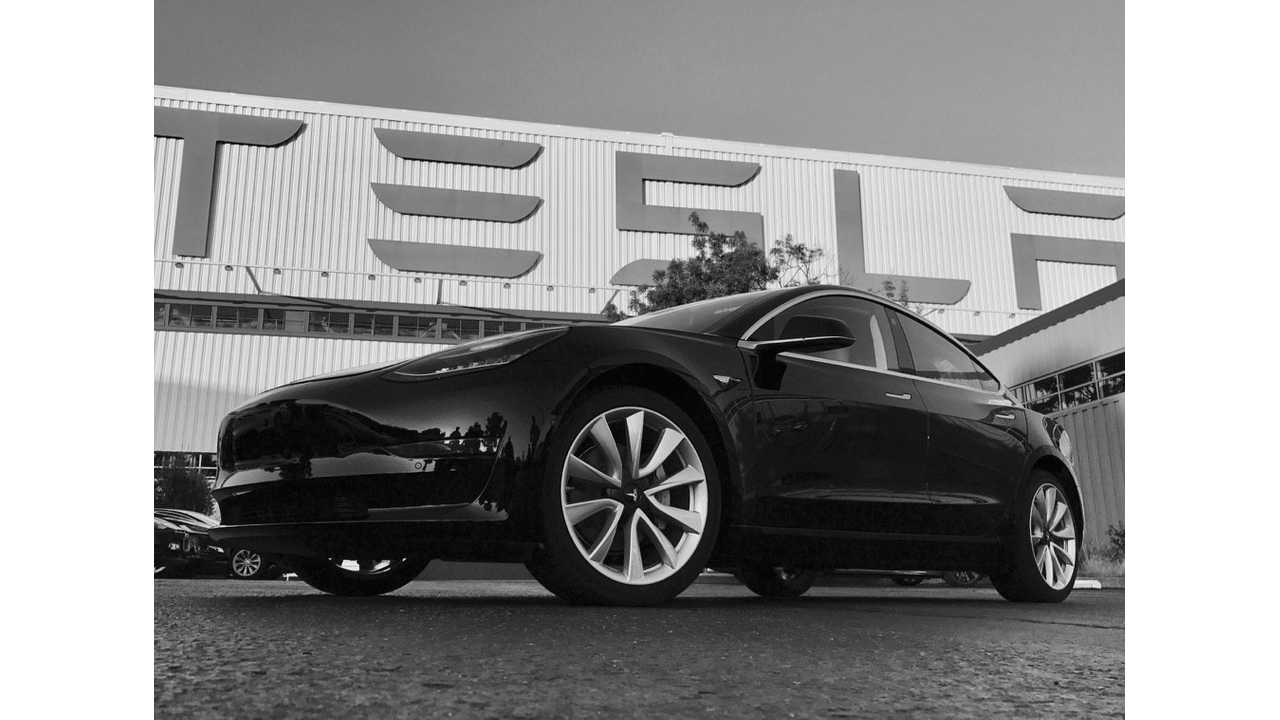This is the first Tesla Model 3 (#001), naturally, it arrived in black - <em>lord of all colors.</em> Want to buy it anyother way? $1,000 <del datetime=