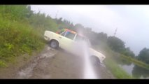 washing car with fire hose