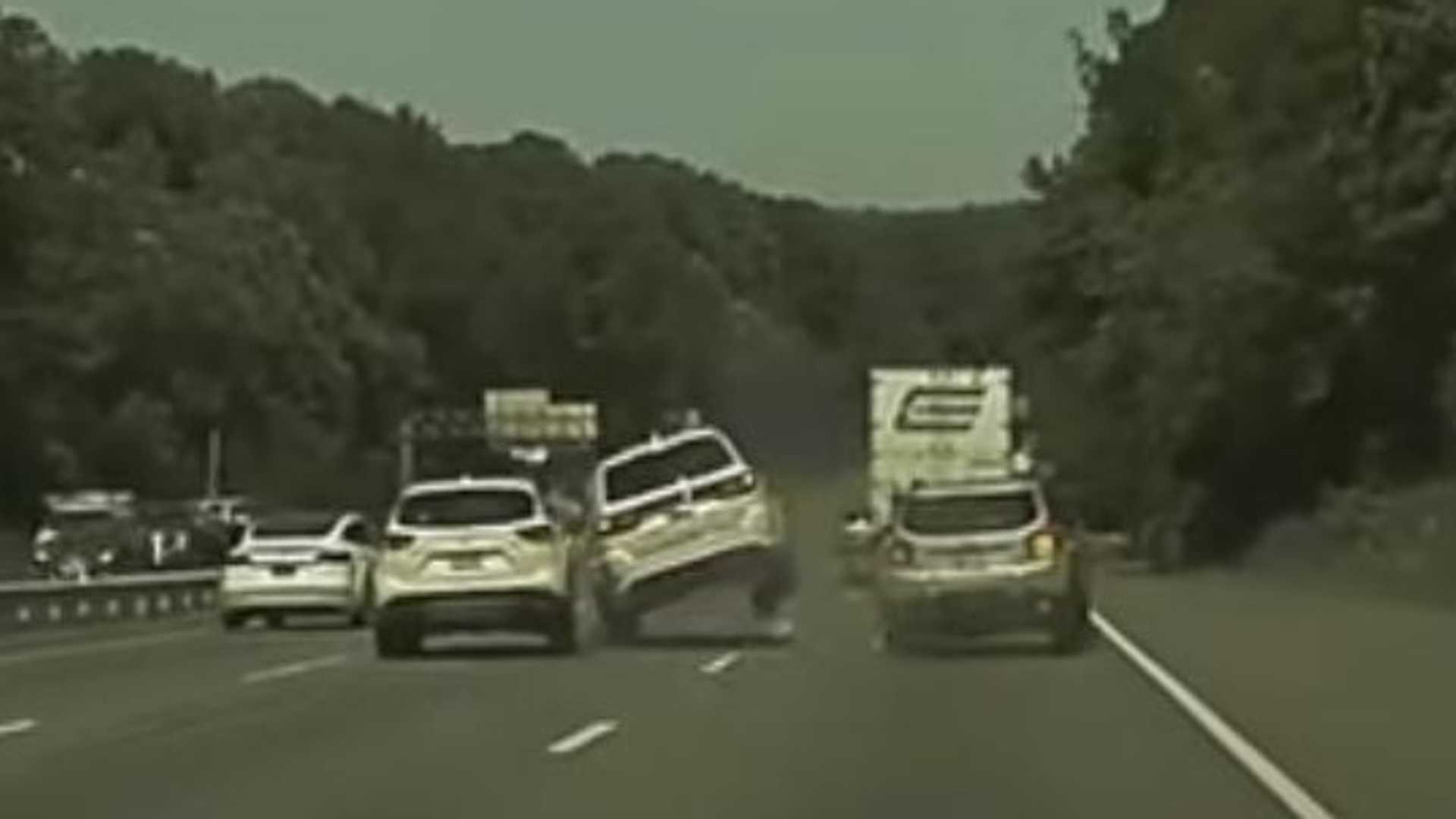 Merging Gone Wrong: Dodge Durango Flies By Tesla Model 3 Then Crashes