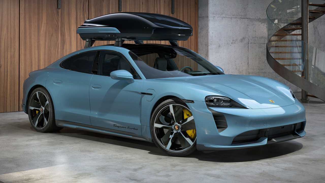 Porsche Taycan Cross Turismo with roof box front three quarters
