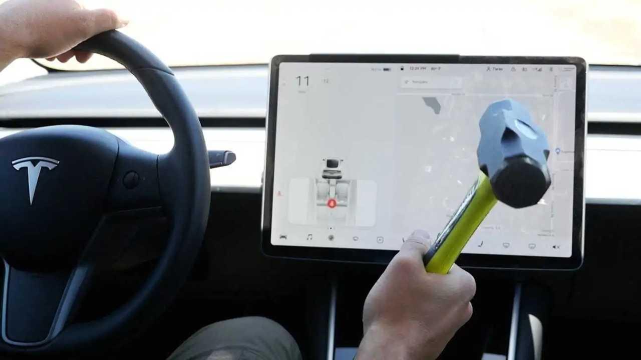 smashing tesla model 3 touch screen while driving