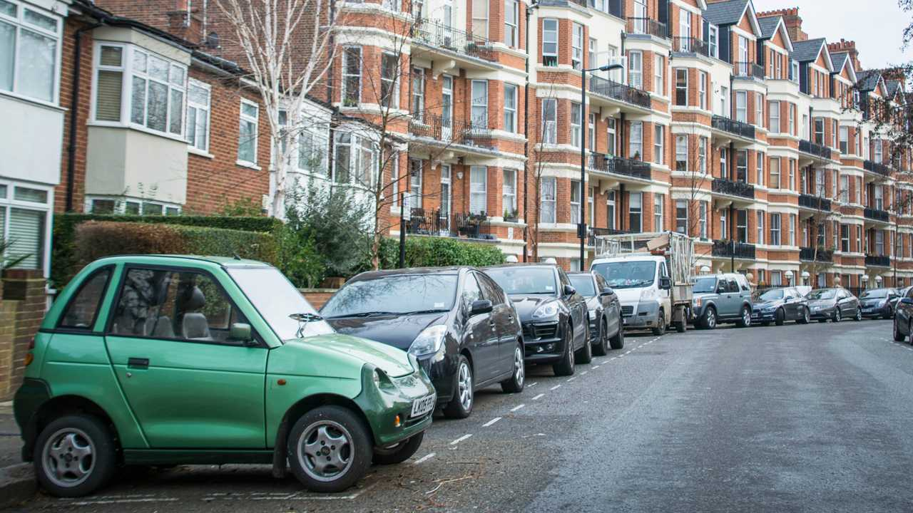 Small electric car parked on residential street in north west London