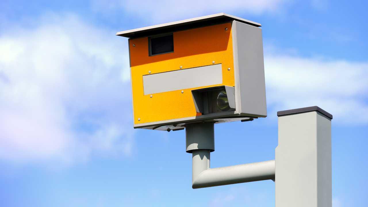 Speed camera against blue sky