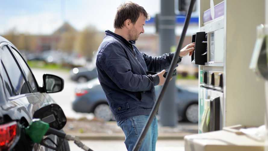 Man making fuel pump payment at petrol station