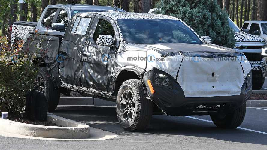 2023 GMC Canyon AT4 Spied Hiding In Parking Lot Under Heavy Camo