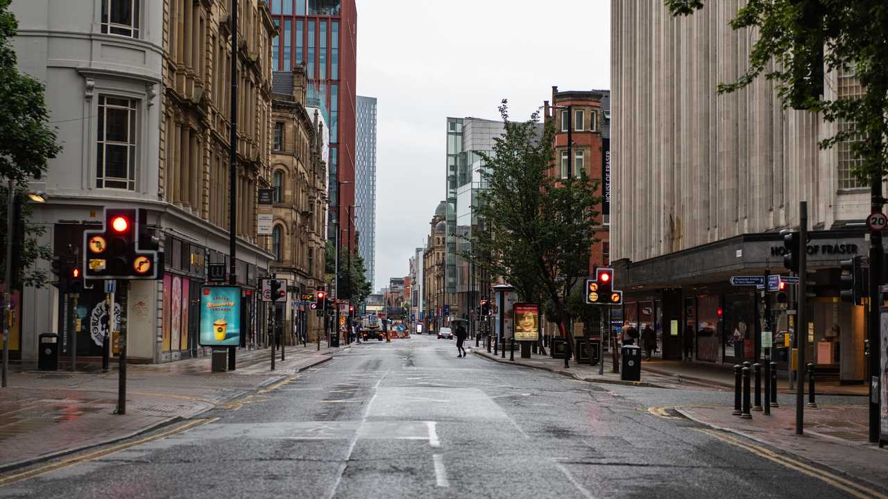Deansgate Manchester UK quiet roads with few people