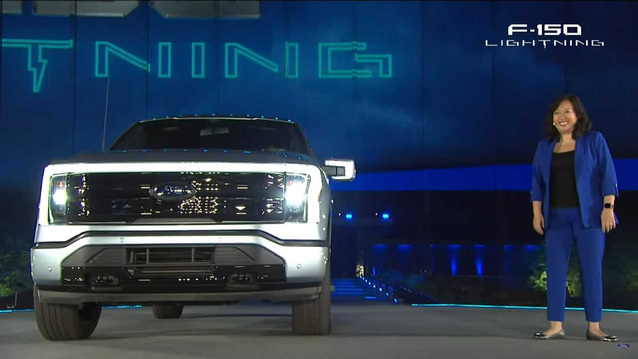 F-150 Chief Nameplate Engineer Linda Zhang stands with the new F-150 Lightning EV.
