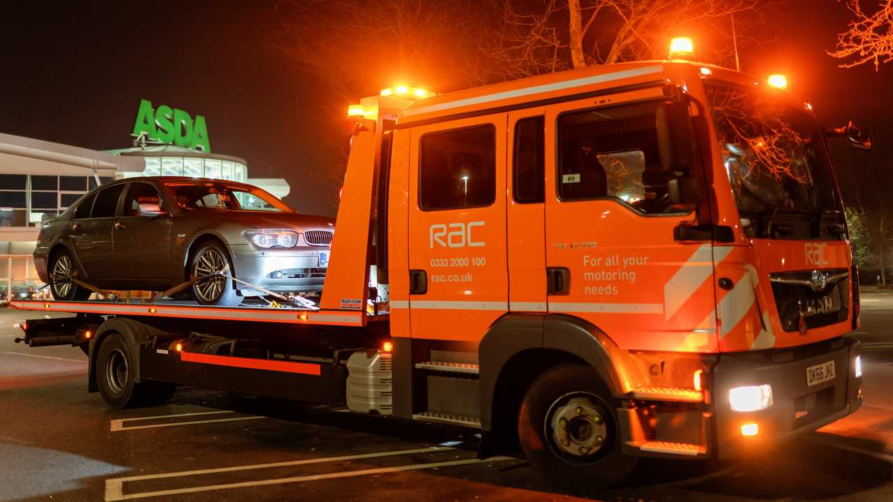 RAC road rescue service truck carrying BMW 7 series