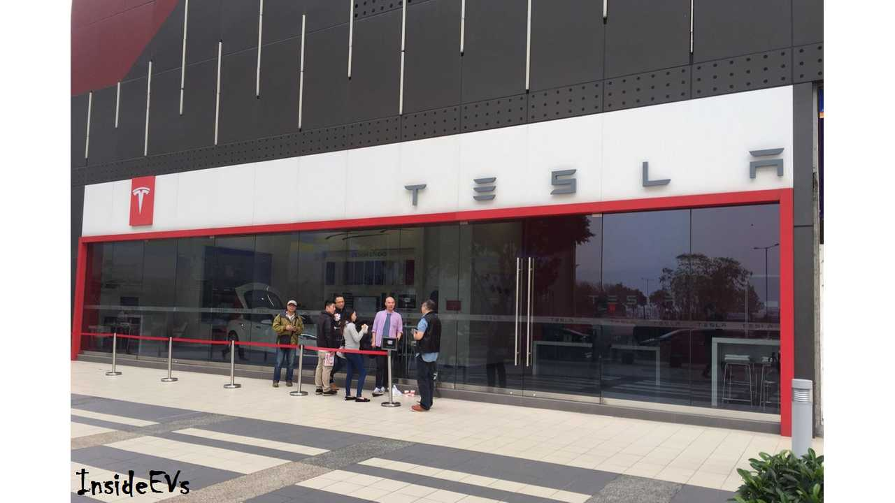 The first new buyers arrived very early at the Tesla store hoping to get their orders in for priority deliver, despite not already being owners