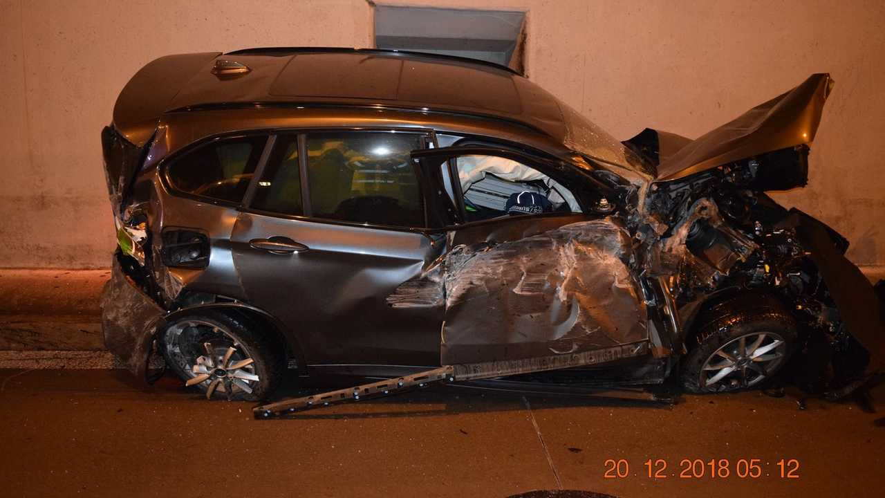 BMW crashes into top of a tunnel