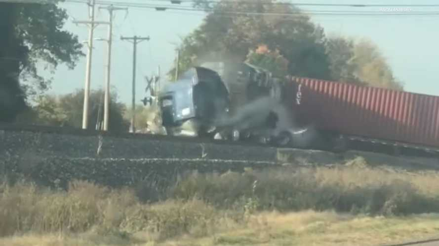 Freight train completely demolishes lorry stuck on tracks