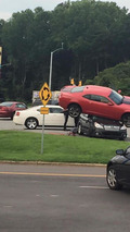 Chevrolet Camaro and Subaru Outback crash