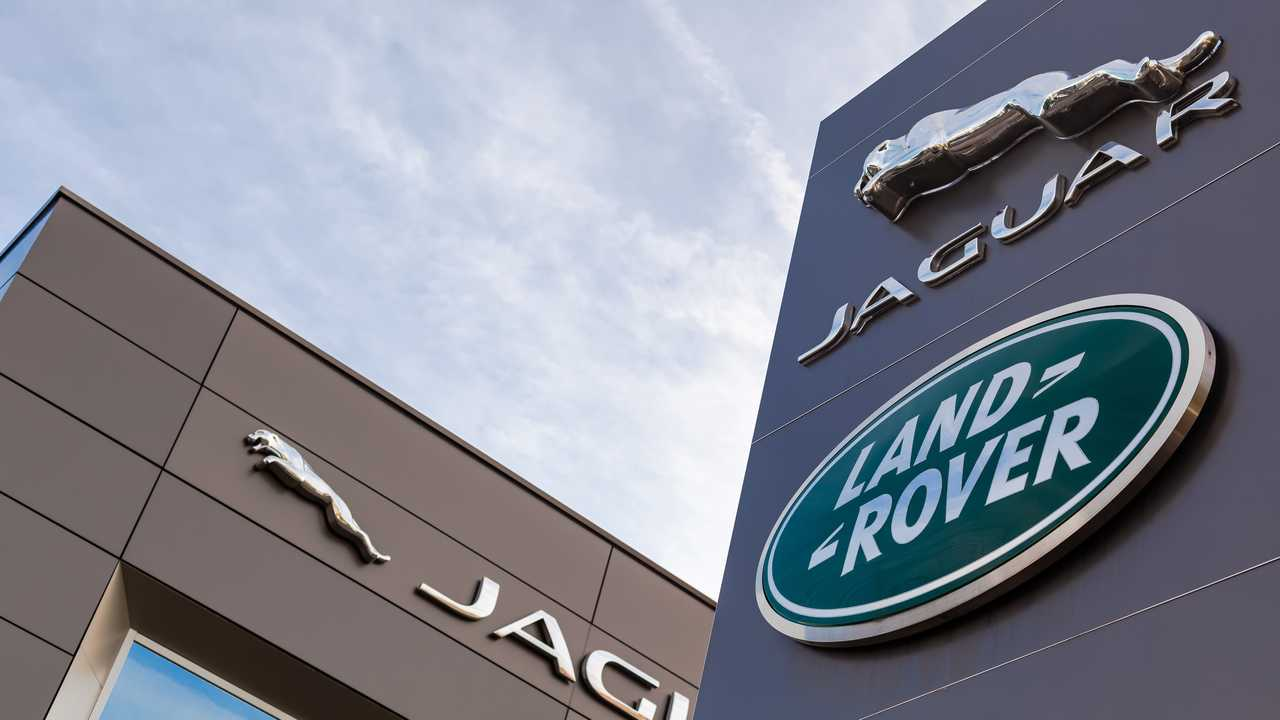 Jaguar Land Rover brand logos on dealership buildings