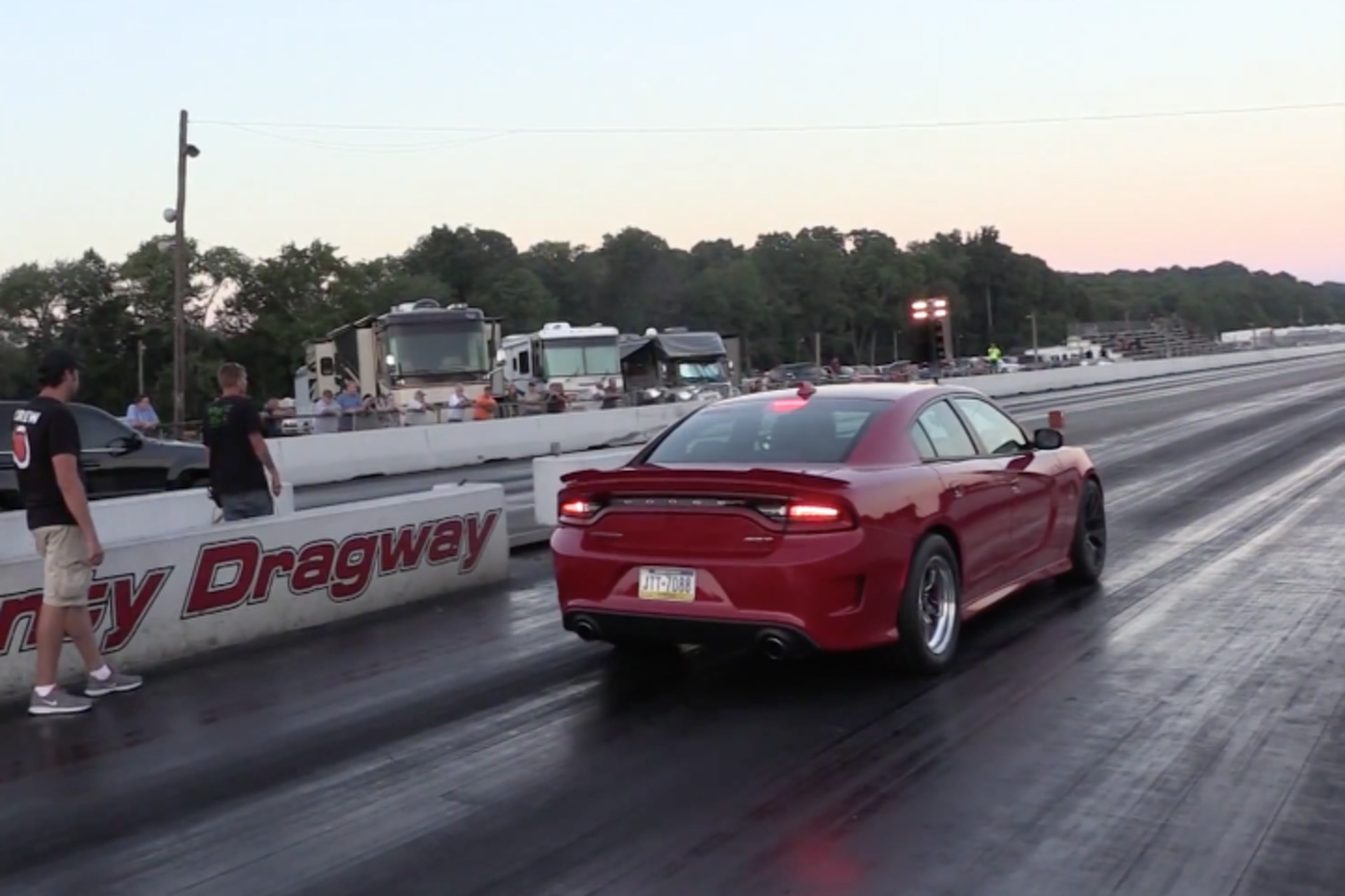 watch the worlds fastest dodge charger hellcat destroy the quarter mile