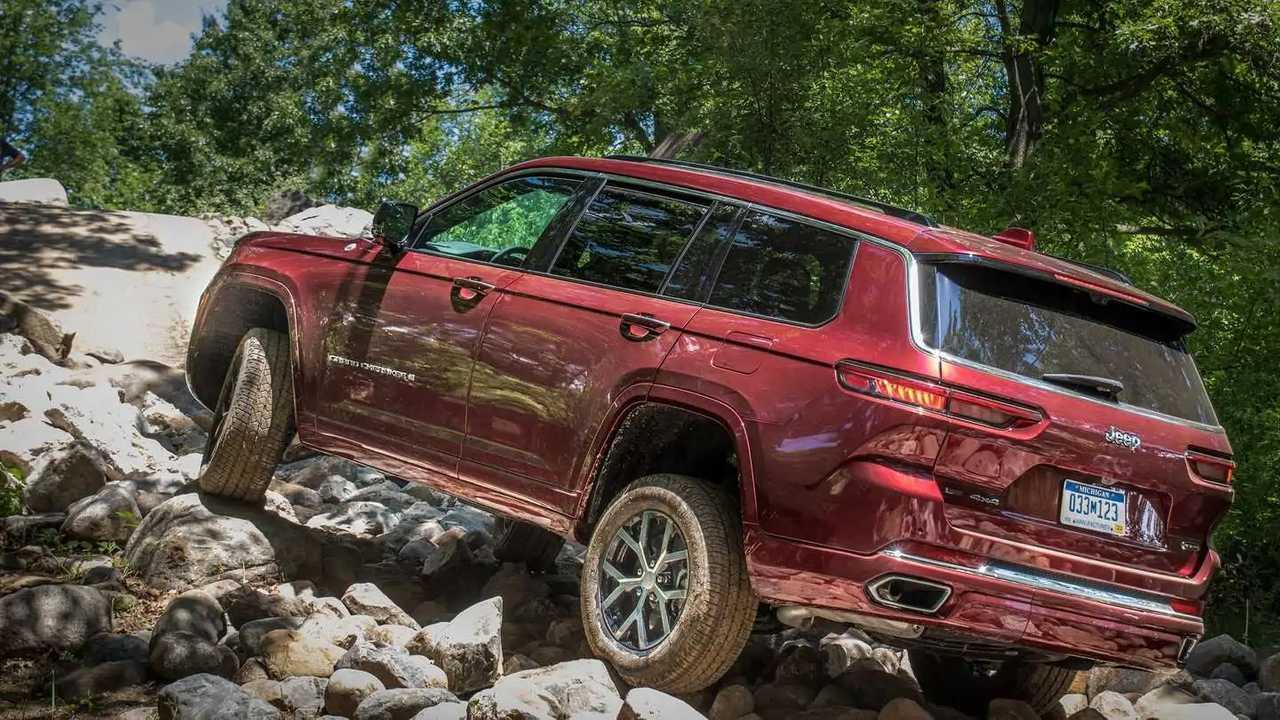 The 2021 Jeep Grand Cherokee L climbing over rocks.