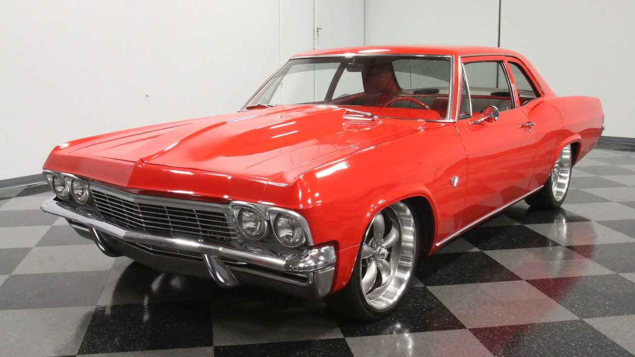 Classic 1965 Chevrolet Bel Air Stuns In A Glossy Red Coat