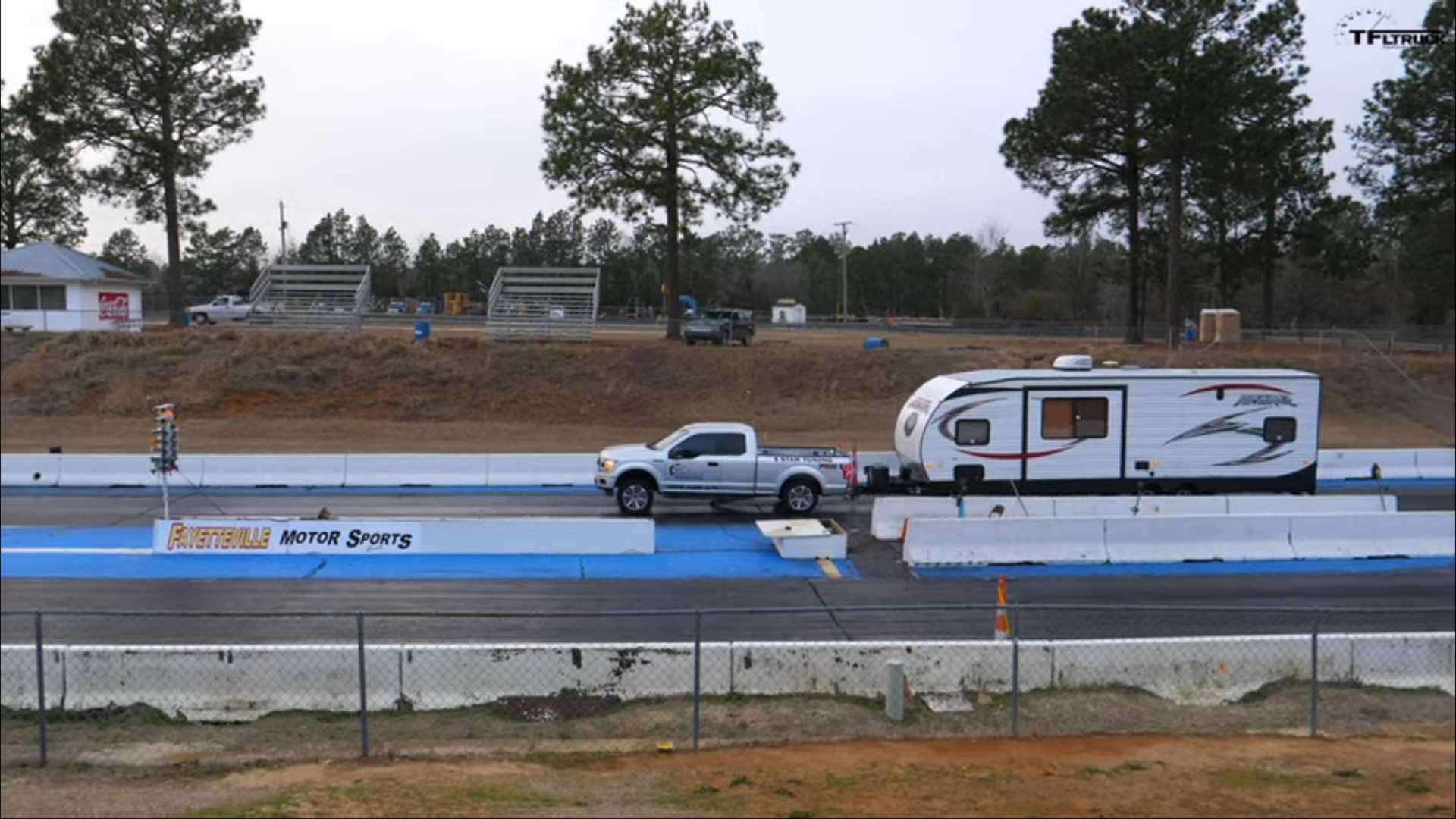 Watch Trailer-Hauling Ford F-150 Break Spectacularly In Drag Race
