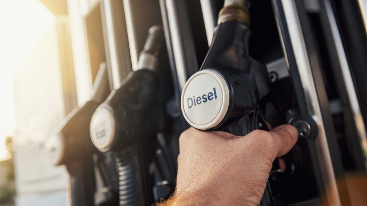 Man hand holding diesel fuel pump nozzle