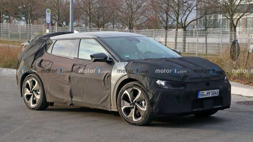 New Kia electric crossover spied still wearing thick camouflage