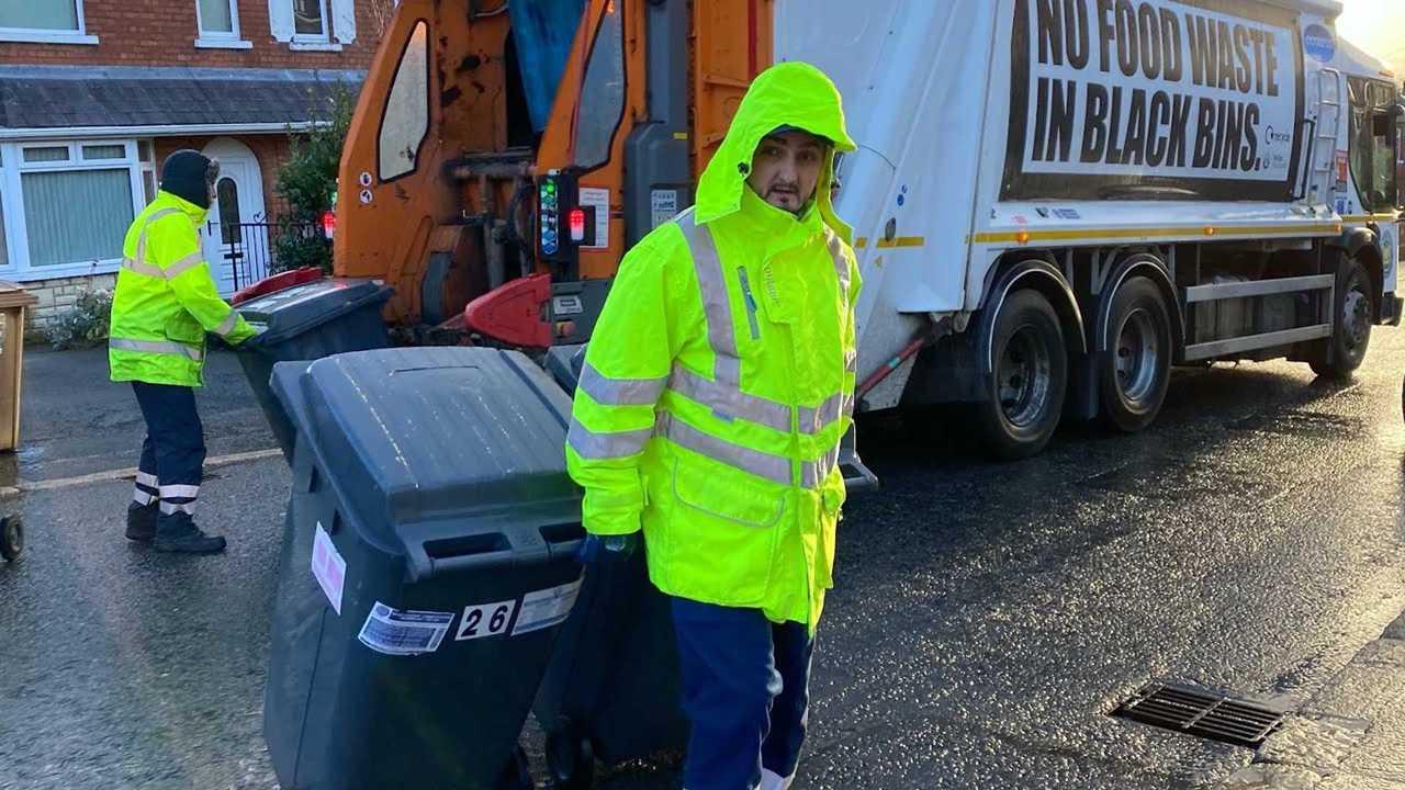 Garbage Man Bashes Tesla