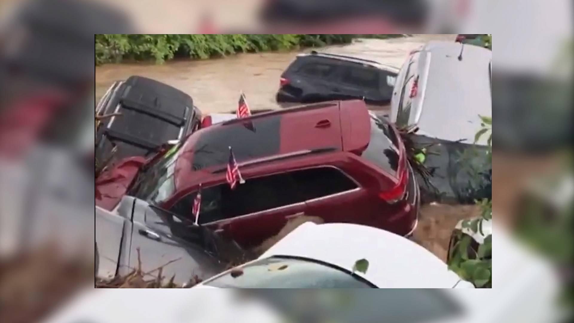 flash flood strikes dodge dealership, sweeps suvs into river