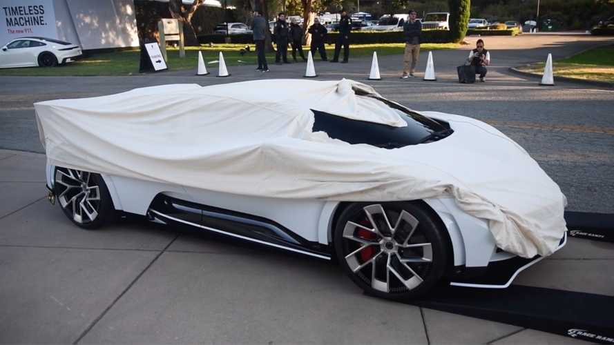 Bugatti Centodieci driven while mostly covered is simply weird
